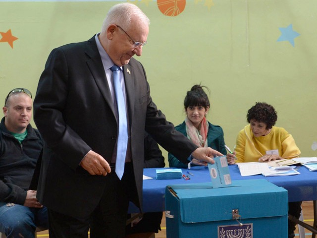 President Rivlin casts his vote for the 20th Knesset