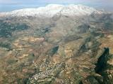 Aeriel view of Ein Kinya, on the Golan Heights with Mount Hermon